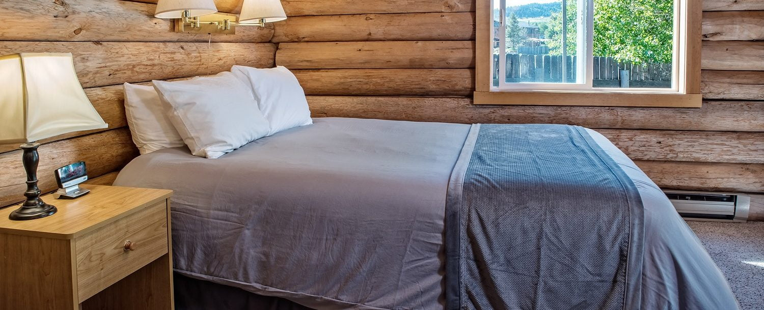 a bed in a Triangle C Cabin rental