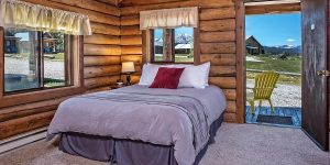 a cabin bedroom at Triangle C Cabins