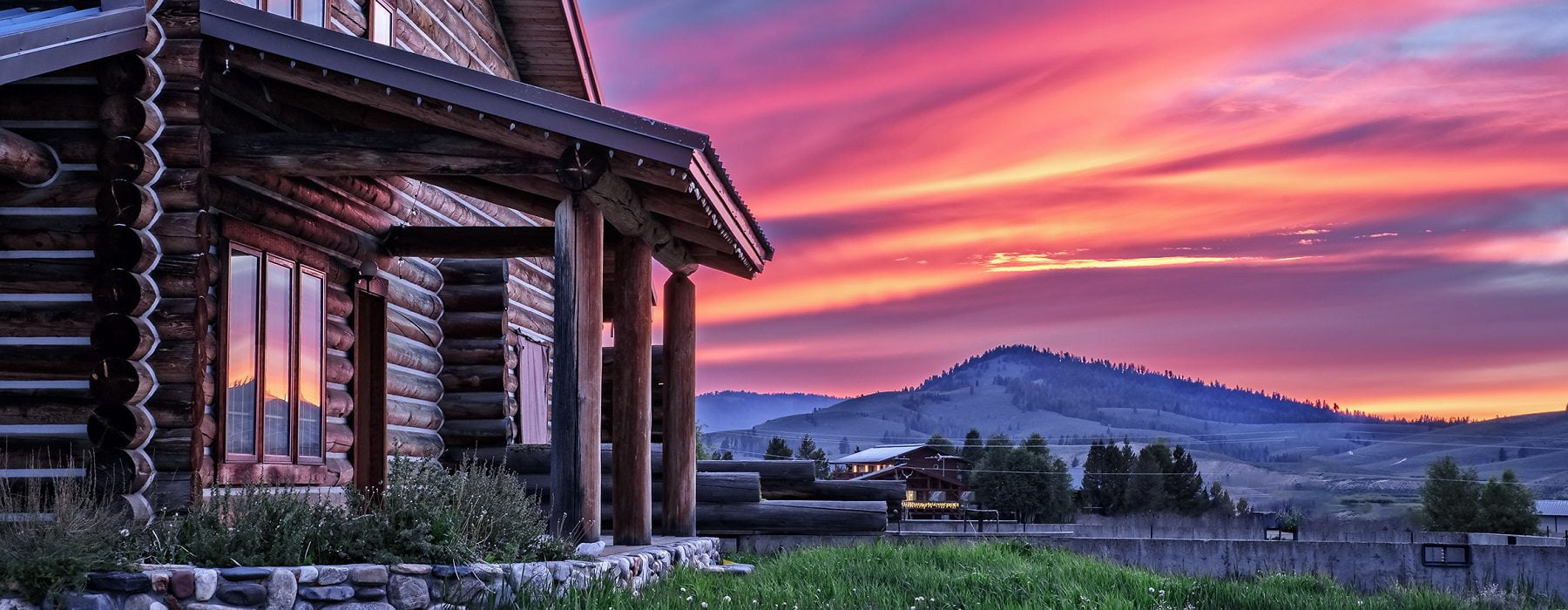 sunset over a Triangle C Cabins rental house