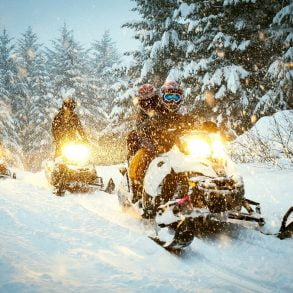 Couple in Idaho Snowmobiling