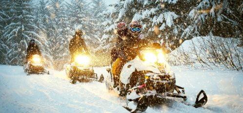Couple in Idaho Snowmobiling