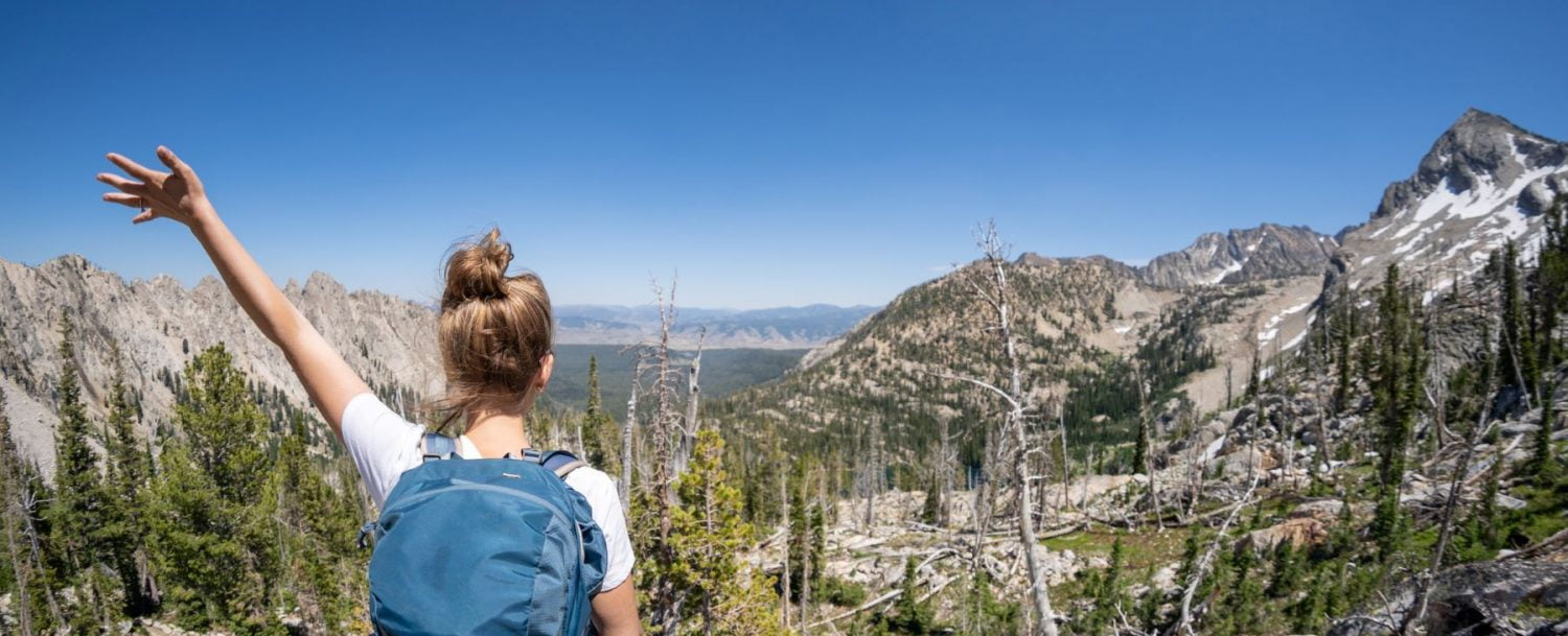 a girl hiking in the Sawtooth Mountains Idaho