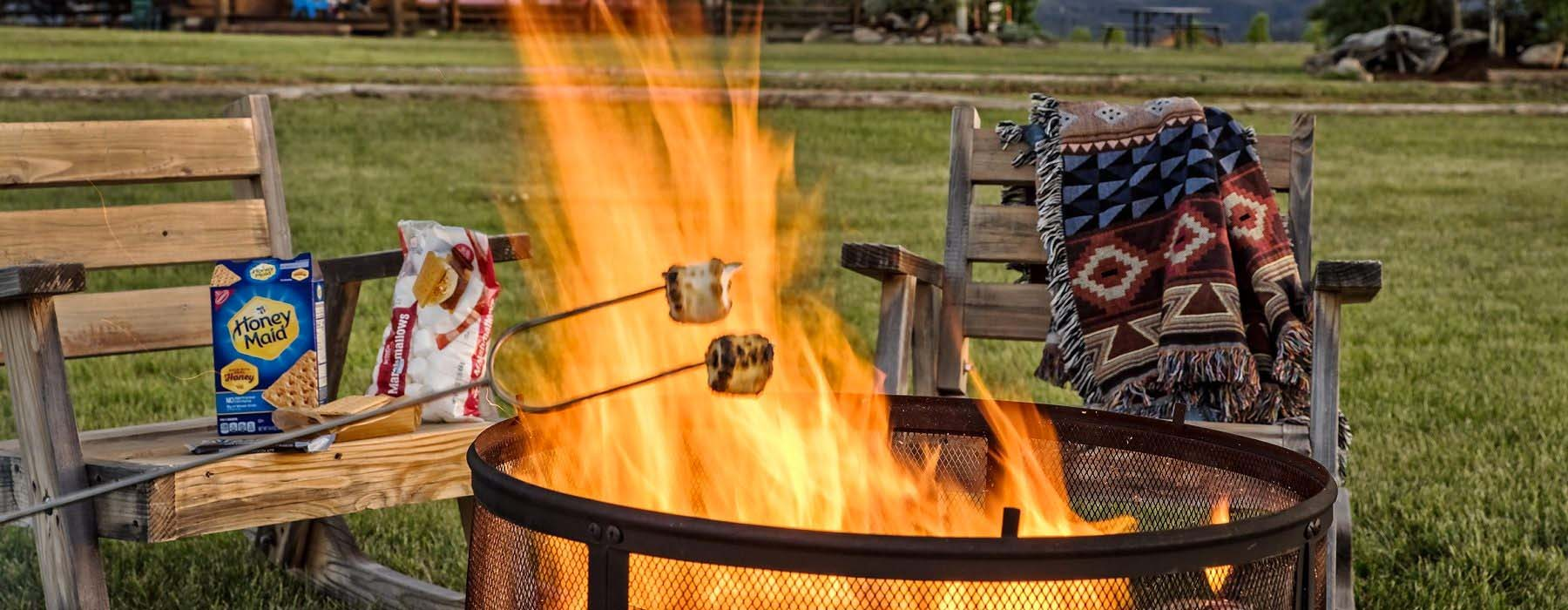 Roasting s'mores over firepit at Triangle C Cabins